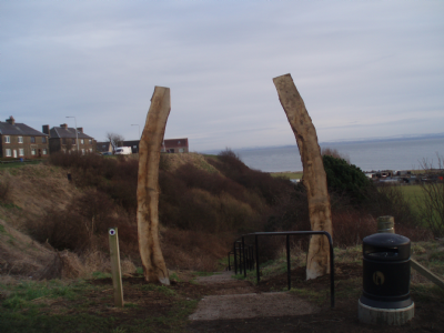 One of 8 path entrance archways, resembling the old whale jawbanes, encourage people walking and are community art in their own right